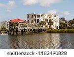 luxury beach houses on the... | Shutterstock . vector #1182490828