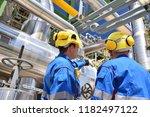 group of industrial workers in... | Shutterstock . vector #1182497122