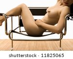 Beautiful Asian Nude Seductively Draped Across a Modern Chair. - stock photo