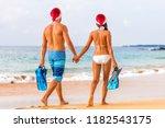 christmas beach couple... | Shutterstock . vector #1182543175