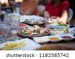family gathering for eating... | Shutterstock . vector #1182585742