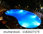 Pool With Blue Water At Night...