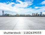 empty square with city skyline... | Shutterstock . vector #1182639055