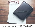 documents and notepad on table | Shutterstock . vector #1182644605