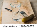 pickled cucumber on a fork and...   Shutterstock . vector #1182680572