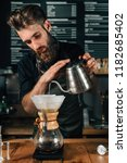 young male barista pouring... | Shutterstock . vector #1182685402