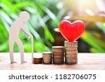 heart model set on money coins... | Shutterstock . vector #1182706075