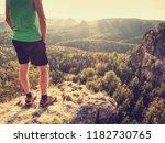 green singlet and black pants... | Shutterstock . vector #1182730765