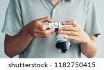 young holding in hands old...   Shutterstock . vector #1182750415