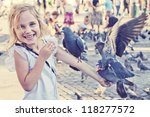 Smiling Girl With Pigeons On...