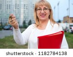 adult woman with keys and... | Shutterstock . vector #1182784138