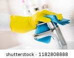 maid hand or charwoman cleaning ... | Shutterstock . vector #1182808888