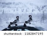 car with ski rack on top.... | Shutterstock . vector #1182847195