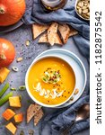 pumpkin soup  top view | Shutterstock . vector #1182875542