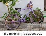 purple bicycle with straw... | Shutterstock . vector #1182881002