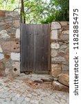 old wooden garden door on slope ... | Shutterstock . vector #1182885475