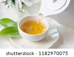 close up pouring hot black tea... | Shutterstock . vector #1182970075