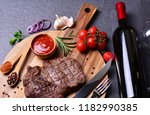 beef steak with wine spices and ... | Shutterstock . vector #1182990385