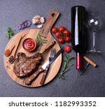 tomahawk steak with spices and... | Shutterstock . vector #1182993352