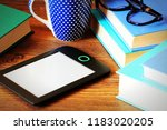 e book reader and books on... | Shutterstock . vector #1183020205