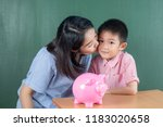asia boy and his mother with... | Shutterstock . vector #1183020658