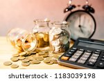 calculator with coin in... | Shutterstock . vector #1183039198