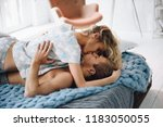 couple in the bedroom on the... | Shutterstock . vector #1183050055