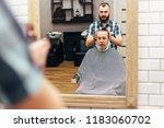 men in barbershop hair care... | Shutterstock . vector #1183060702