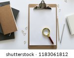 top view over the working desk... | Shutterstock . vector #1183061812