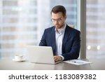 serious millennial businessman... | Shutterstock . vector #1183089382