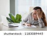 bored millennial female worker...   Shutterstock . vector #1183089445
