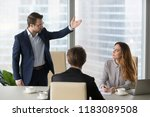 mad male worker gesturing... | Shutterstock . vector #1183089508