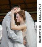 young wedding couple enjoying... | Shutterstock . vector #1183110505