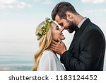 happy wedding couple in suit... | Shutterstock . vector #1183124452
