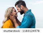 side view of smiling couple... | Shutterstock . vector #1183124578