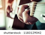 acoustic guitar close up... | Shutterstock . vector #1183129042