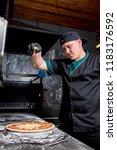 the cook prepares pizza in... | Shutterstock . vector #1183176592