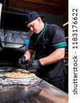 the cook prepares pizza in... | Shutterstock . vector #1183176622