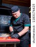 the cook prepares pizza in... | Shutterstock . vector #1183176625