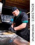 the cook prepares pizza in... | Shutterstock . vector #1183176628