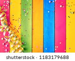 rainbow colored wood carnival... | Shutterstock . vector #1183179688