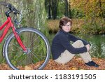woman with bicycle sitting in... | Shutterstock . vector #1183191505