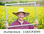 farmer with photo frame is... | Shutterstock . vector #1183193095