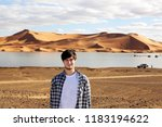 young man in the desert at the... | Shutterstock . vector #1183194622