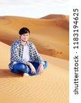 man alone in the desert on the... | Shutterstock . vector #1183194625