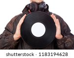 man with acoustic lps | Shutterstock . vector #1183194628