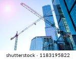 Three High Rise Cranes Against...