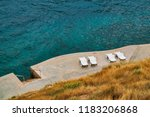 sunbeds on the shore top view | Shutterstock . vector #1183206868