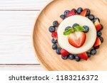 yogurt pudding with fresh... | Shutterstock . vector #1183216372
