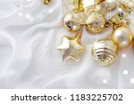 gold christmas ornaments on... | Shutterstock . vector #1183225702